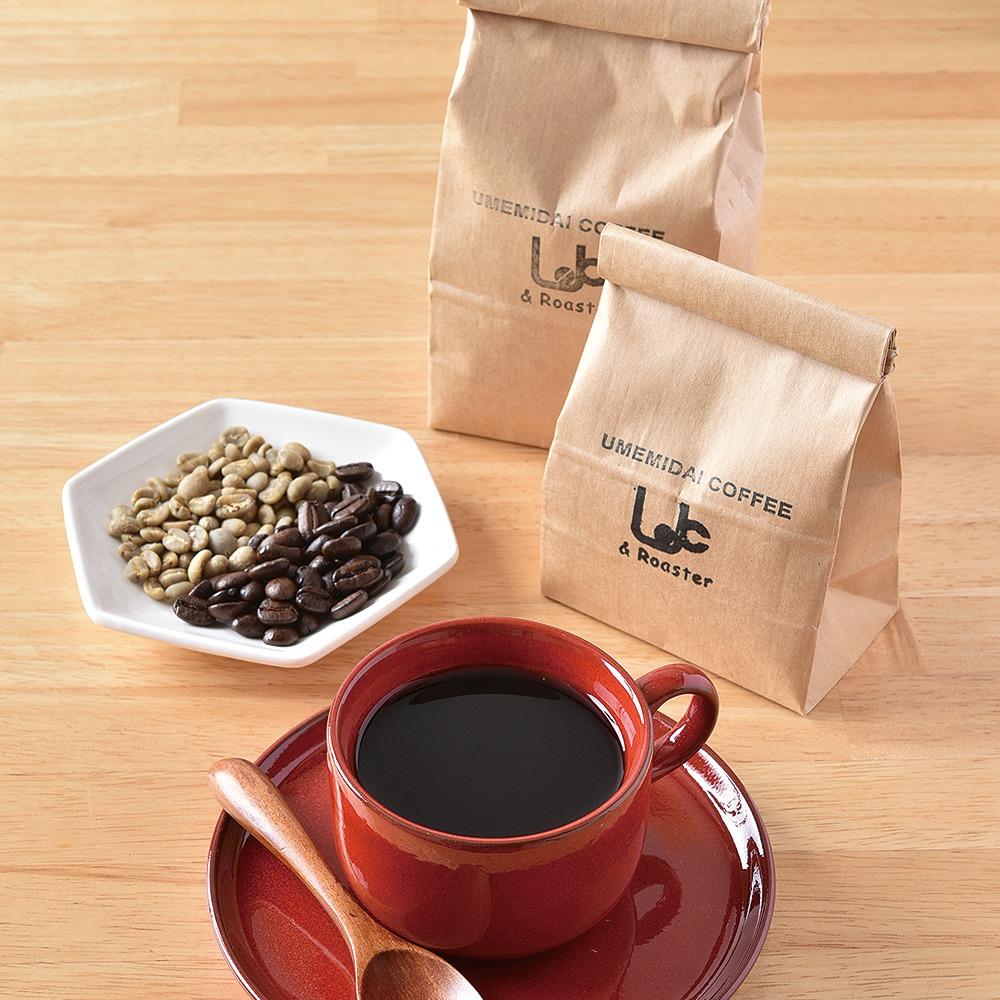 yomiっこ珈琲特集掲載店。木津川市、UMEMIDAI COFFEE & Roaster、西大寺駅前にあった1971年創業「つかさ珈琲店」が5年前に木津川市へ移転。「豆は鮮度が命」と語る店主が、煎りたて挽きたての豆を、昔ながらのサイフォンで丁寧に淹れる。熱々のコーヒーはすっきりでまろやかだ。お代わりは200円とお得。
